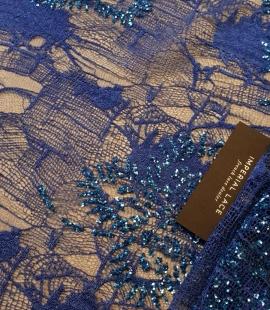 Zila pērļotta mežģīņu audums