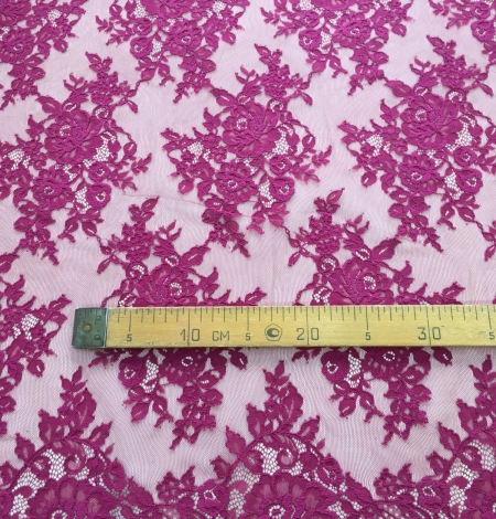 Raspberry red lace fabric. Photo 10