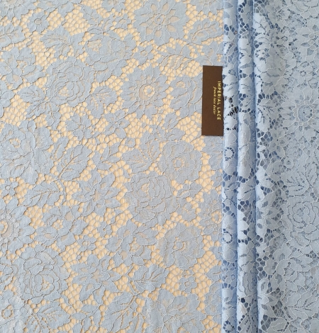 Light blue floral pattern guipure lace fabric. Photo 1