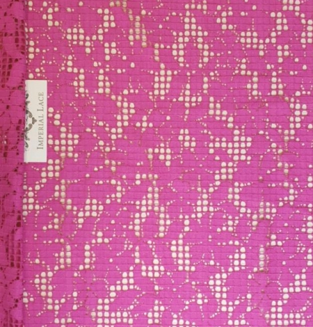 Fuchsia pink floral guipure lace fabric. Photo 1