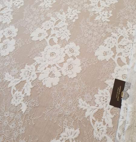 Off White  guipure with chantilly pattern lace fabric. Photo 1