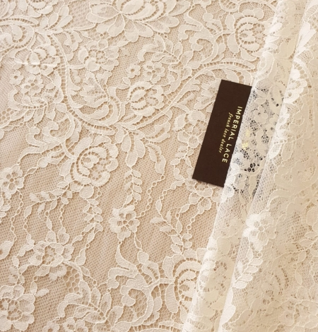 Ecru 100% polyester floral and stripes guipure lace fabric. Photo 1
