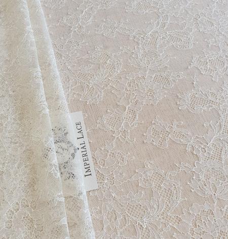 Ecru chantilly elastic lace fabric. Photo 2