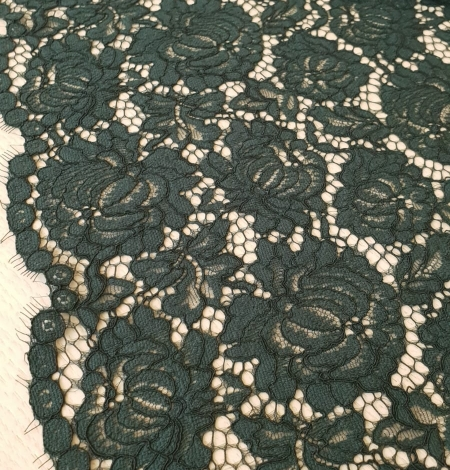 Dark green cotton polyester chantilly lace fabric . Photo 2