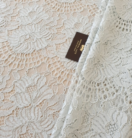 Light grey with bluish green guipure lace fabric. Photo 1