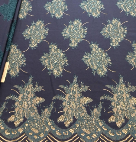 Dark lilac lace fabric. Photo 1