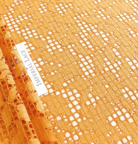 Rust tone color chantilly lace fabric. Photo 2