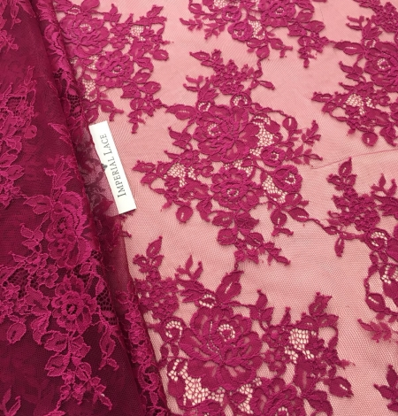 Raspberry red lace fabric. Photo 1