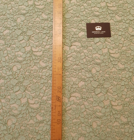 Light apple green guipure lace fabric. Photo 7