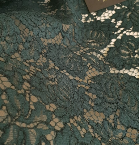 Dark green cotton polyester chantilly lace fabric . Photo 3
