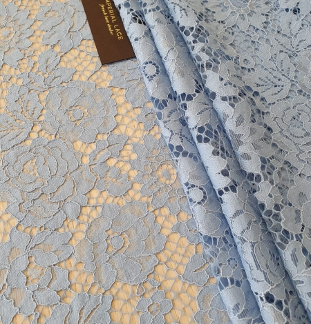 Light blue floral pattern guipure lace fabric. Photo 2