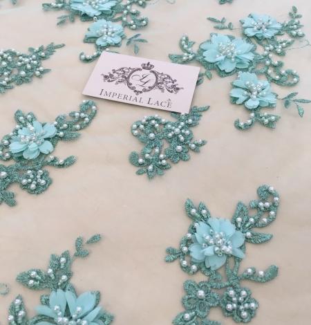 Zaļa 3D ziedu raksta mežģīņu audums. Photo 3