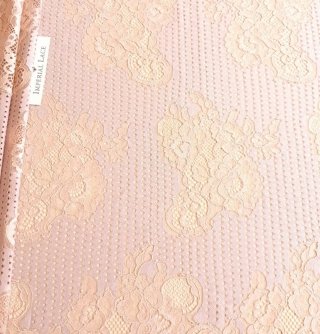 Powder color lace fabric . Photo 1