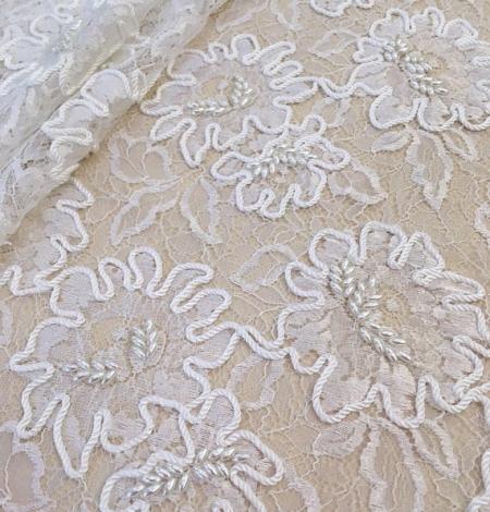 Balts ar izšuvumu mešģīņu audums. Photo 1