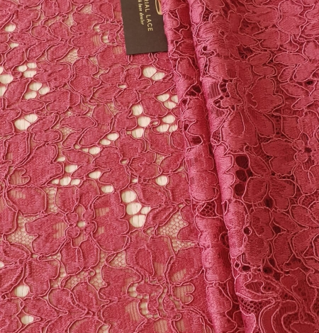 Rasberry pink 100% polyester floral guipure lace fabric. Photo 1