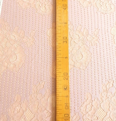 Powder color lace fabric . Photo 7