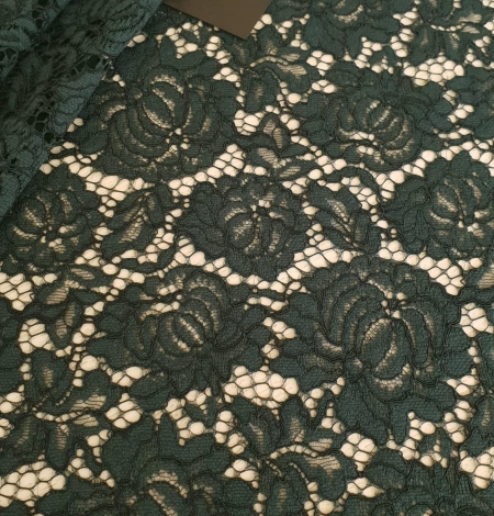 Dark green cotton polyester chantilly lace fabric . Photo 1