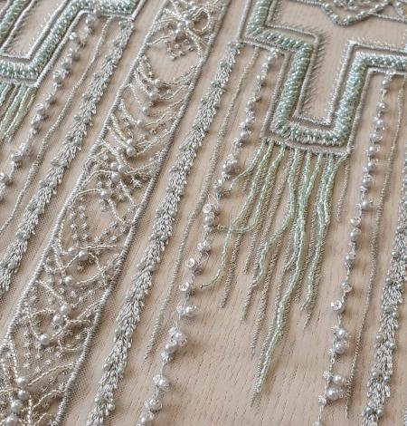 Gaiši zaļa ģeometriska pērļota ar nokarenām deteļām mežģīņu audums. Photo 7