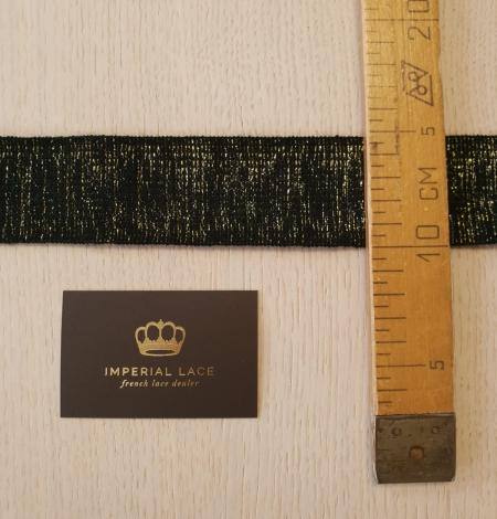 Melns ar zelta gumijas lentes aplikācija. Photo 7