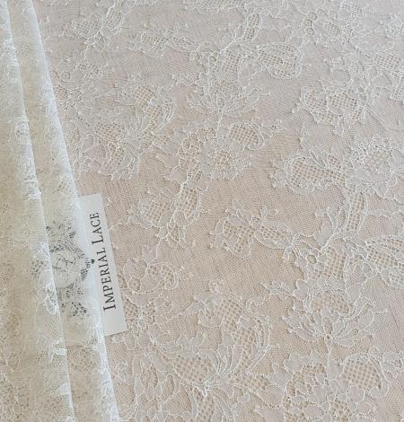 Ecru chantilly elastic lace fabric. Photo 1