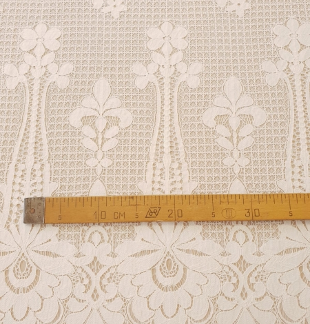 Ivory 100% polyester floral guipure lace fabric. Photo 11