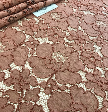 Brown lace fabric. Photo 1
