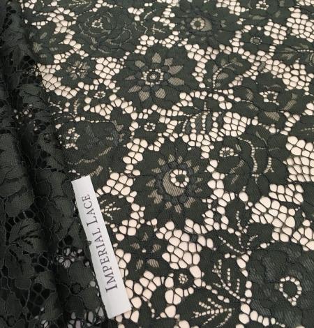 Green lace fabric. Photo 1