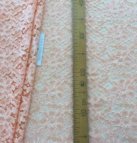Orange lace fabric. Photo 6