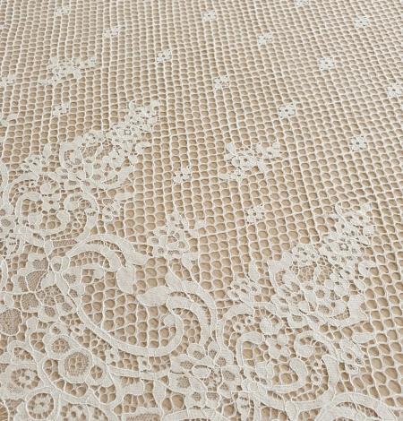 Ivory mesh floral guipure lace fabric. Photo 1